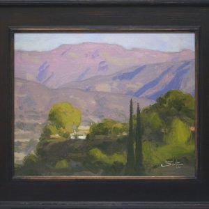 Bright Ojai Morning, giclee print by Dan Schultz. Green, sunlit foreground with Italian Cypress trees and a pink mountain background with purple shadows.