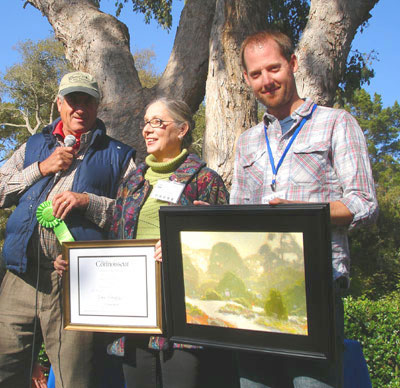 Dan Schultz receives award at the 2012 Carmel Plein Air Show in Carmel, California, from award judge Gil Dellinger.