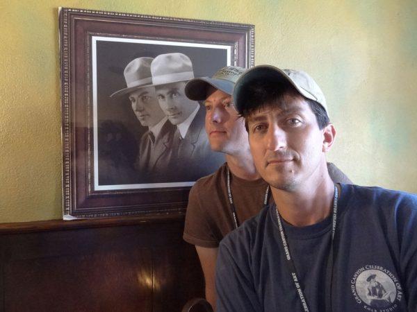 Dave Santillanes and Dan Schultz posing with the Kolb Brothers photo at Kolb Studio in Grand Canyon National Park.