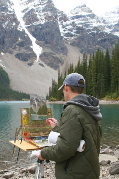 Dan Schultz Painting at Moraine Lake in Banff National Park, Canada