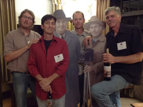 Josh Been, Dave Santillanes, Dan Schultz and Bill Cramer posing with the Kolb Brothers in Kolb Studio at Grand Canyon National Park.