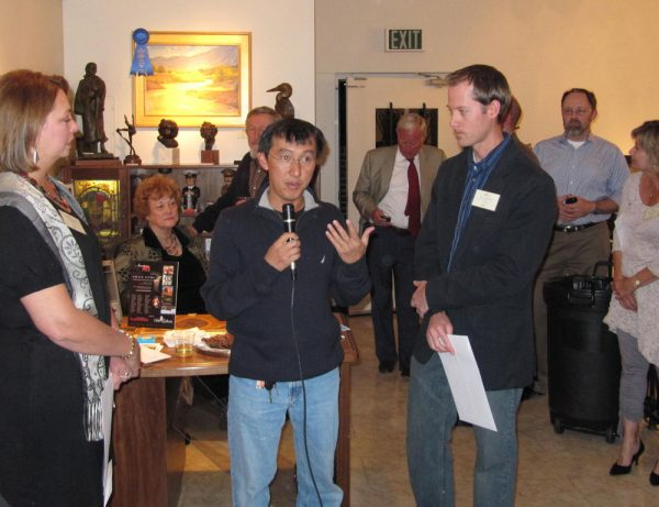 Quang Ho presents first place award to Dan Schultz at the American Impressionist Society 10th Annual National Show at Saks Gallery in Denver, Colorado.