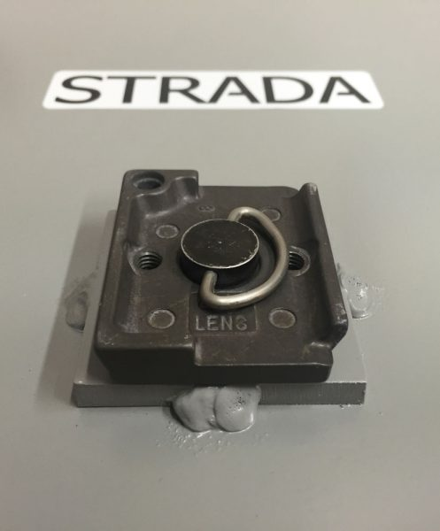 Quick-release tripod mount on the bottom of the Strada Pad.