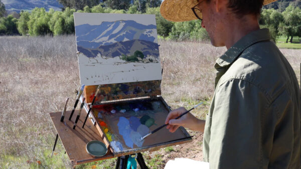 Dan Schultz starting an oil painting outdoors in California with his Open Box M pochade box mounted on a camera tripod.
