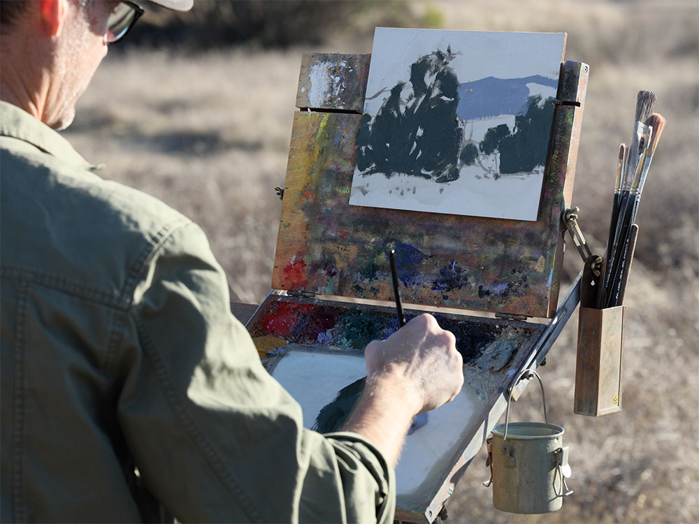Dan Schultz working on a landscape and problem solving while painting outdoors